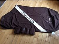 Brown Fleece travel rug and bandages horse