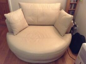 Cream leather swivel chair from M&S, as new condition,