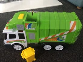 Assorted toddler toys including bin truck, Noah's ark, bus and car