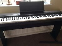 Casio CDP 100 electronic piano with stand