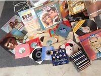 Assortment of records and cds