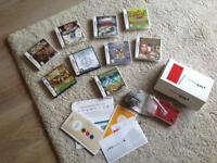 Nintendo DSi in Red, boxed and complete with all instruction manuals, Stylus etc. Plus 9 games!