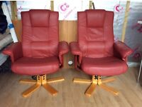 2 Rustic red reclining and swivel chairs in good condition the pair ono.