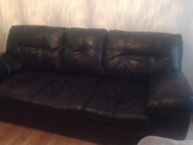 Black leather 3 seater couch, chair and pouffe.