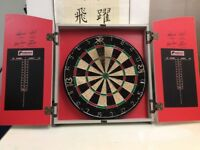 Dartboard and Cabinet used in excellent condition !!