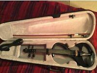 Electric violin with case and bow. £120 ono