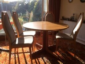 Round and extending table and 4 chairs