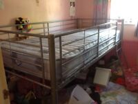 Single metal mid-rise sleeper bed