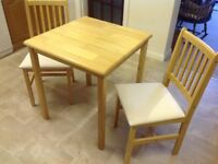 Dining table and two chairs.
