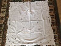 Small, almost square, white cotton patterned cloth.