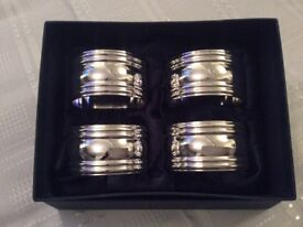 A Boxed Set of Silver Metal Napkin Rings.
