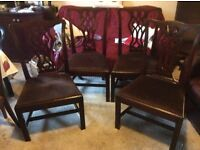 Four antique Chippendale style dining room chairs