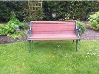 Restored wrought iron and mahogany garden seat.