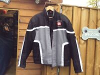 Textile jacket for motorcycle