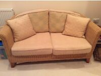 Two seater cane sofa, two cane armchairs and matching stool, good condition