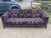 Pair of large sofas by Heals. Silver/grey background with raised purple velvet fern/leaf design