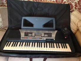 Yamaha electric organ------PSR. 350-----with floppy disc drive