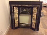 Cast Iron fireplace inset includes tiles. Excellent condition