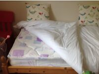 Solid pine single bed and nearly new mattress