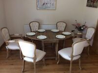 Beautiful Dining Table and four chairs with 2 Carvers