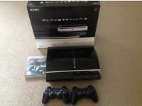 PlayStation 3 60gb and two controllers and game