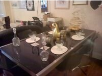 BLACK GLASS AND METAL TABLE PLUS CHAIRS