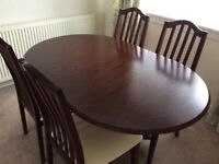 Lovely extendable pedestal table and chairs