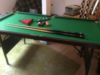 Excellent condition snooker table with 2 cues, balls and triangle