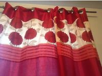Lined red curtains with flowers