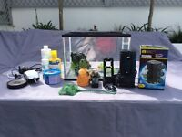 Fish tank with all the accessories - new filter, lights, tank decoration, white stones and net
