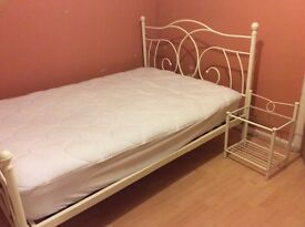 Cream double bedframe and side cabinets