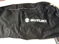 Black Suzuki motorbike dust cover