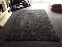 Black and dark grey rug