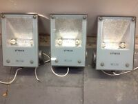 three heavy duty flood lights