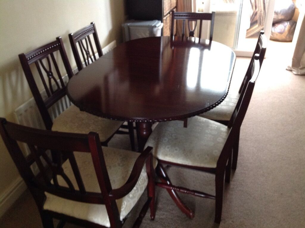 Dining table and matching sideboard chairs offers