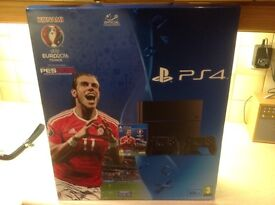 Brand new unopened PS4 console with 2 controllers and PES 2016