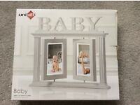 Baby photo frame, white wood, in box, never opened, excellent condition, swivel frames, holds 4 pics