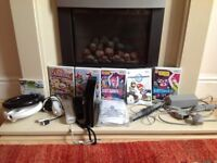 Nintendo Wii console bundle with 6 games