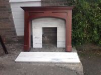 Wooden fire surround plus marble back plate and hearth.