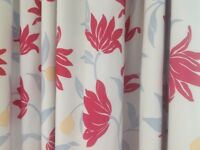 A huge pair of floral print, pencil pleat curtains with blackout lining