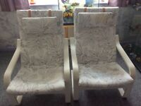 2 black and white Ikea Poang chairs