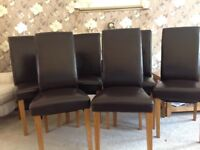 6 brown leather look dining chairs in very good condition