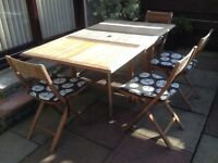 Drop leaf wooden table and chairs can store chairs under table