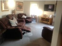 3 piece suite in brown fabric with recliners