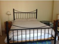 Heavy wrought iron double bed