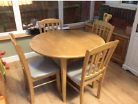 Round drop leaf table and four chairs