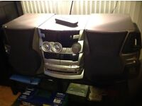 Kenwood 160watt stereo system with 3 cd tray and twin cassette, twin super woofers.