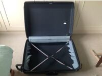 Large Samsonite suitcase with wheels. Dark grey. Combination locks. Used but in good condition