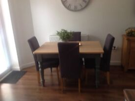 Set of four dining chairs in charcoal grey