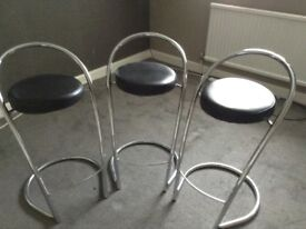 3 black and chrome bar stools for breakfast bar